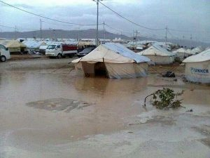 Rains flood refugee camps in Dohuk Governorate of the Kurdistan Region of Iraq (KRI). The KRI is currently hosting 200,000 displaced Syrians and nearly 800,000 displaced Iraqis. Another one million Iraqis are desperately seeking shelter in other parts of Iraq.