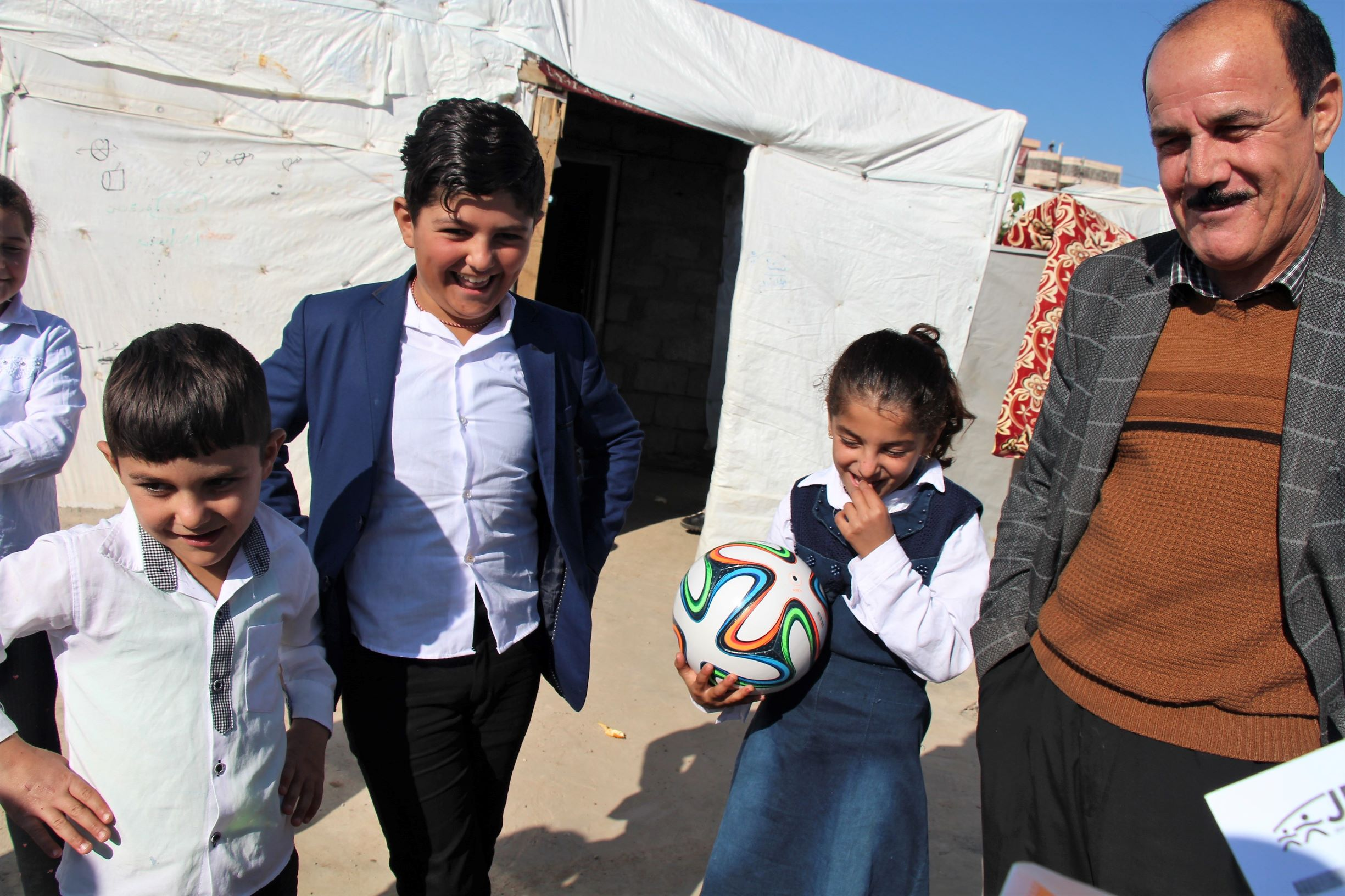 Girl receives a soccer ball