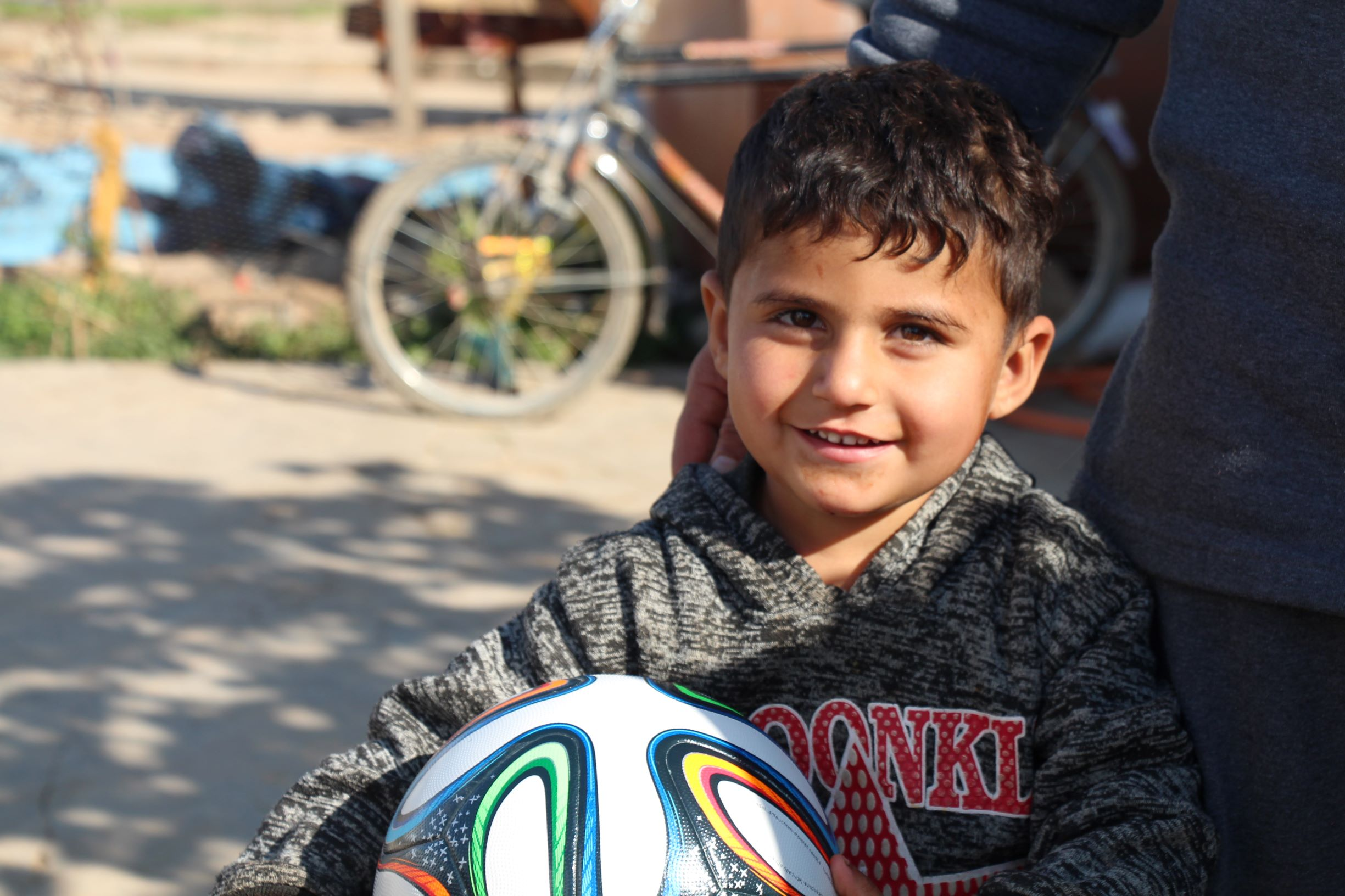Soccer Salam delivery to a child in Sharya